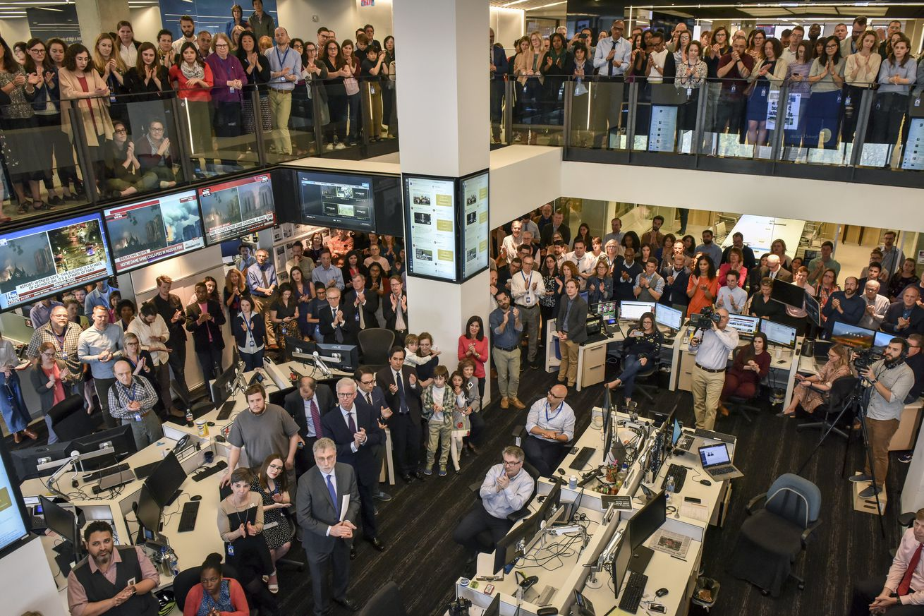 Reporters and editors watch news of the Pulitzer prizes in the newsroom of the Washington Post, in Washington, DC.