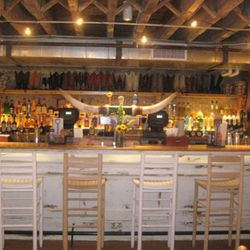 The basement boot bar (lined with cowboy boots).