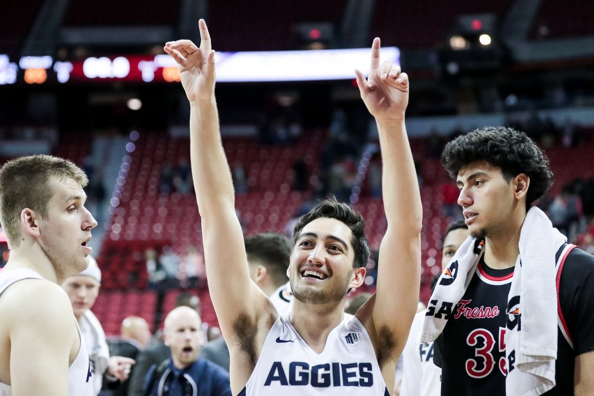 Utah State Aggies guard Abel Porter (15) celebrates his team's win over the against the Fresno State Bulldogs in a Mountain West Conference semifinal game at the Thomas & Mack Center in Las Vegas on Friday, March 15, 2019.