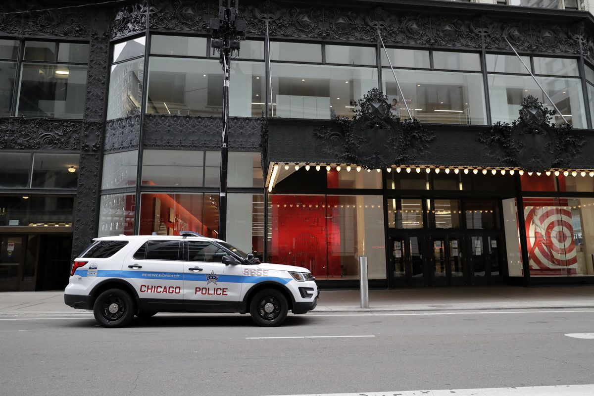 A Chicago Police car is parked in front of a Target store in downtown Chicago on Sunday.