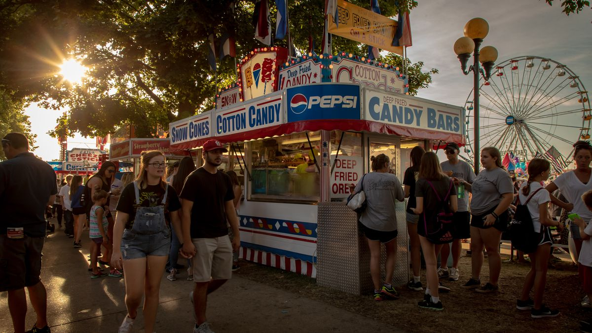 A stand at the Iowa State Fair surrounded by people
