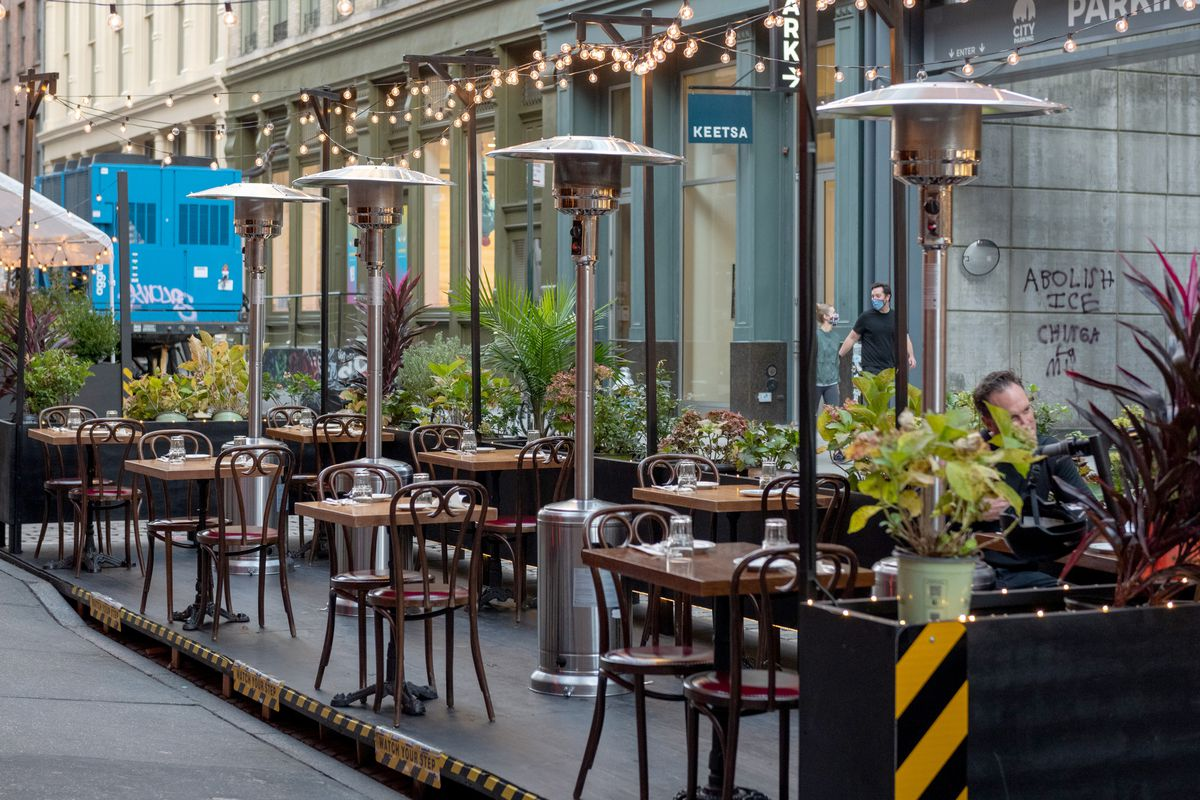 Propane heaters are set up next to outdoor tables at Antique Garage Soho on October 15, 2020 in New York City.
