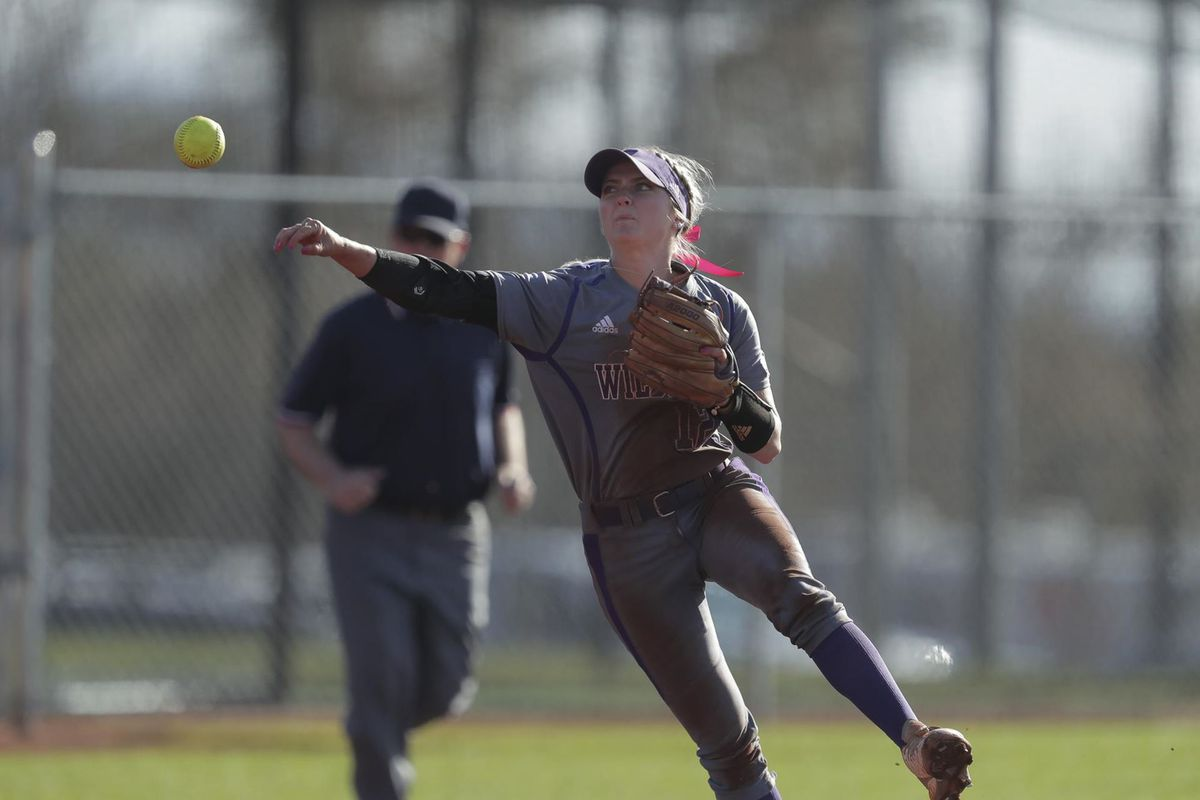 Sydney White throws the ball in a game against Montana. Weber State swept a doubleheader against Montana Friday afternoon.