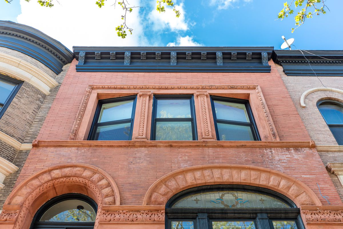 Facade restoration is nearly complete on this historic Brooklyn townhouse.
