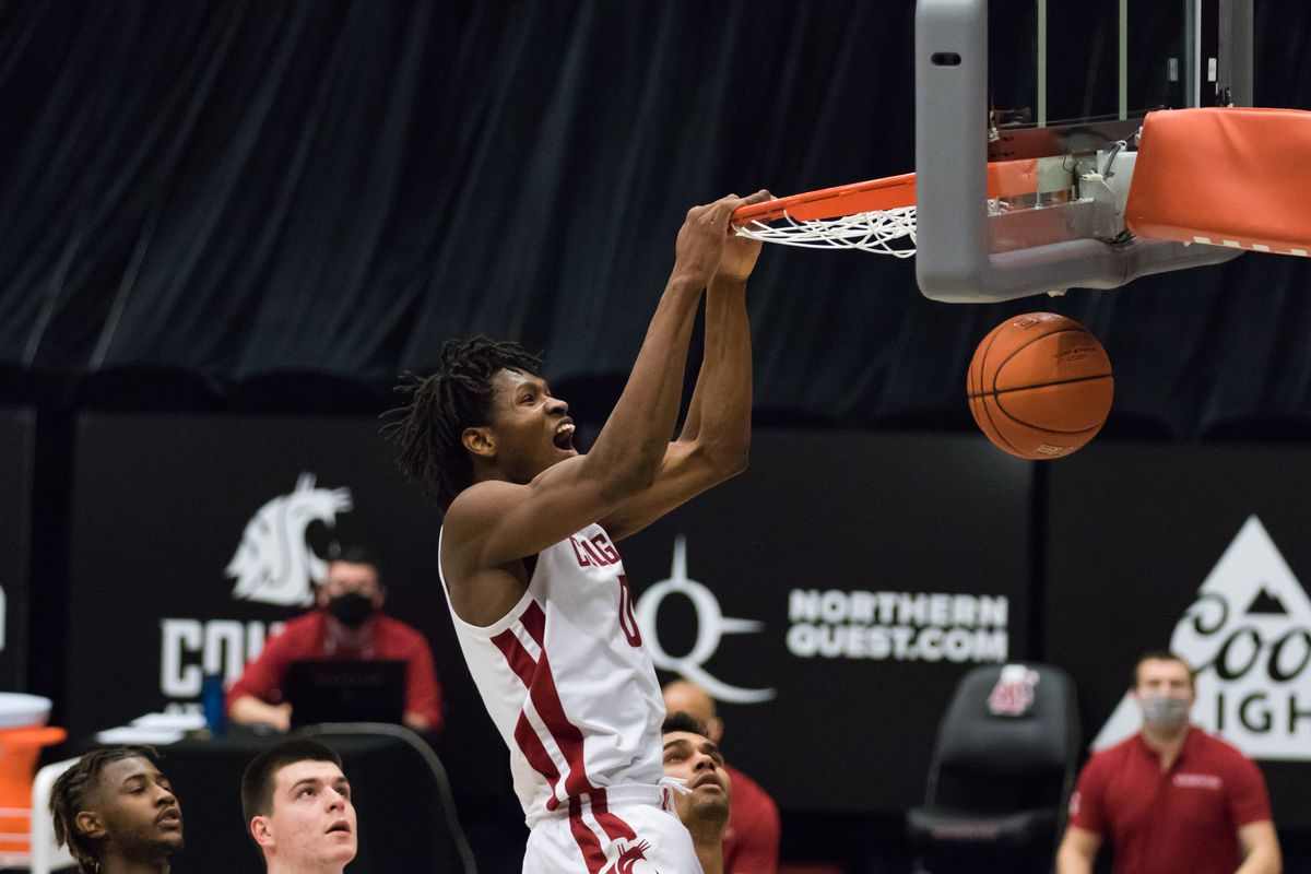 PULLMAN, WA - FEBRUARY 20: Washington State center Efe Abogidi (0) throws down a monster slam during the second half of a Pac 12 matchup between the Stanford Cardinal and the Washington State Cougars on February 20, 2021, at Beasley Coliseum in Pullman, WA.