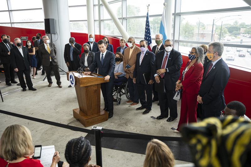 Transportation Secretary Pete Buttigieg speaks about the infrastructure bill and the aid it will bring to communities during a tour of the CTA Red Line 95th St/ Dan Ryan Station on Friday.