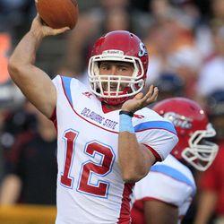 Delaware State quarterback Nick Elko (12) passes against Cincinnati in the first half of an NCAA college football game, Saturday, Sept. 15, 2012, in Cincinnati.
