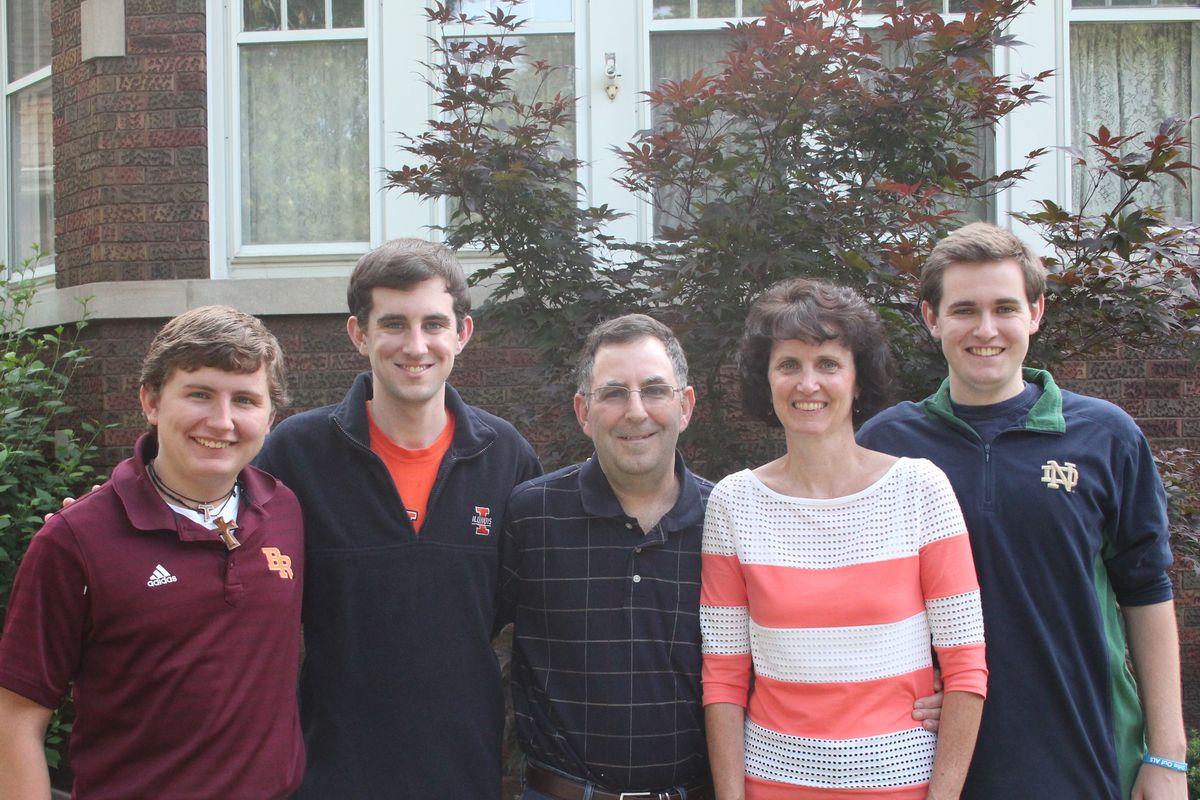 Meg and John Rooney (center) and their children (from left) Dan, Ned and Jack.