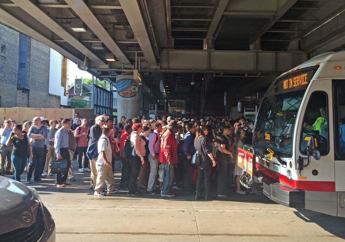 The area under the Belmont CTA station became crowded and the situation grew tense as commuters tried to get downtown Tuesday. | Emily Moon/For the Sun-Times