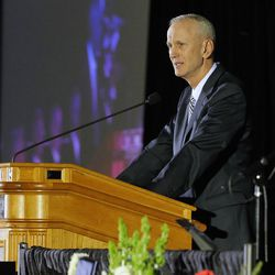 Former quarterback Robbie Bosco speaks on behalf of the football team as tamily, friends and former team members gather to honor former BYU football coach LaVell Edwards at a memorial service at the Provo Convention Center on Friday, Jan. 6, 2017.