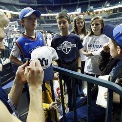 BYU's Tyler Haws signs autographs for a group of kids from Oklahoma after practice Wednesday at the Ford Center. BYU plays Florida on Thursday in the NCAA first round.