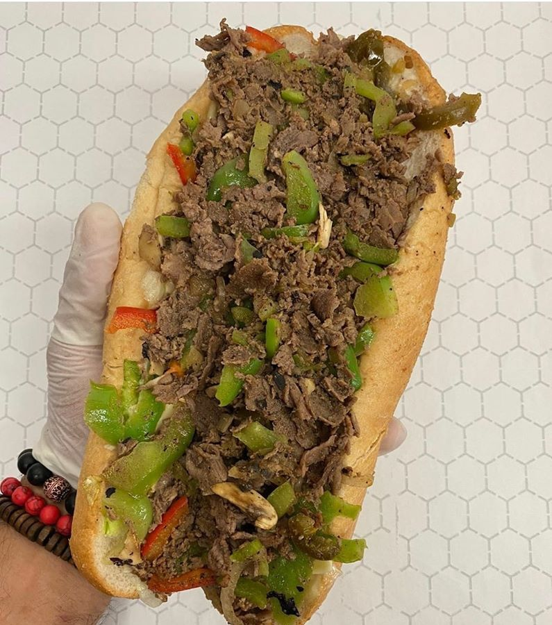 A cheesesteak stuffed with meat and peppers at the Original Philly's