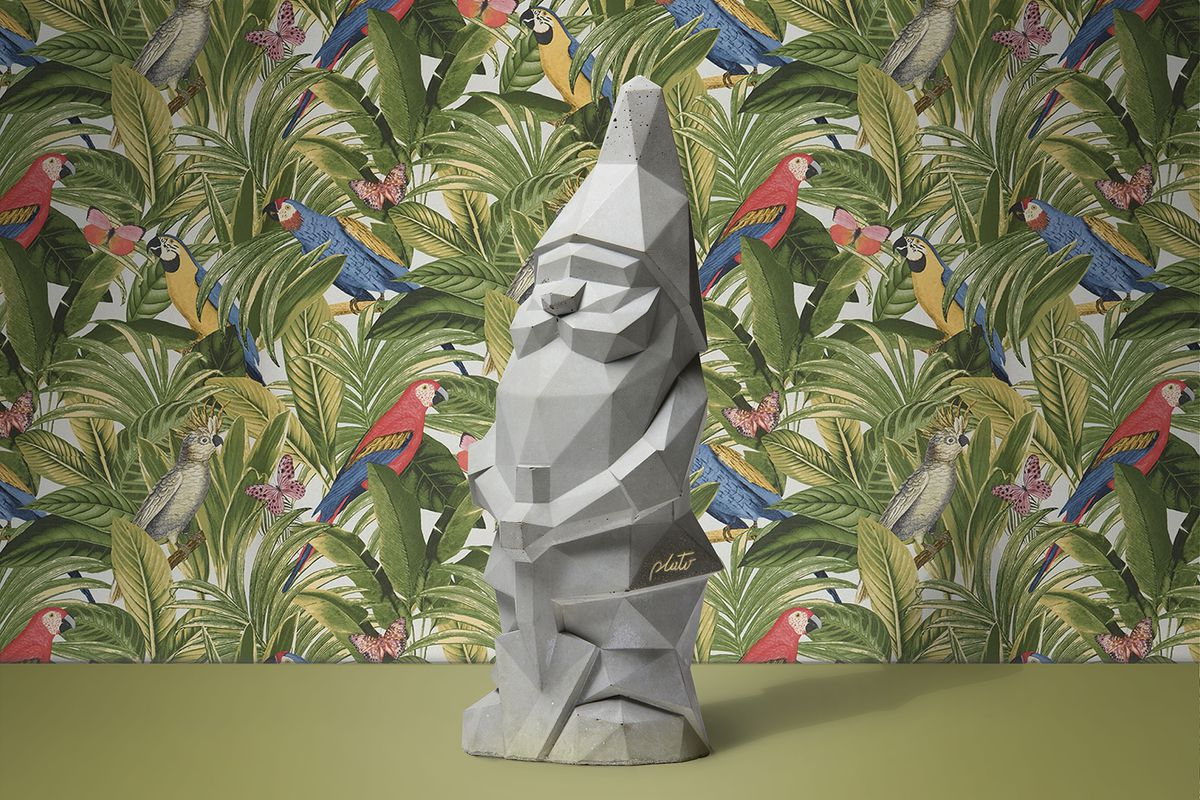 Garden gnome in front of floral wallpaper