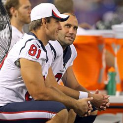 Aug 9, 2013; Minneapolis, MN, USA; Houston Texans quarterback Matt Schaub (8) talks with tight end Owen Daniels (81) on the bench during the second quarter against the Minnesota Vikings at the Metrodome.