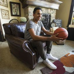 Lone Peak High's Frank Jackson Monday, April 27, 2015, at home in Highland talks about colleges, mission and family.