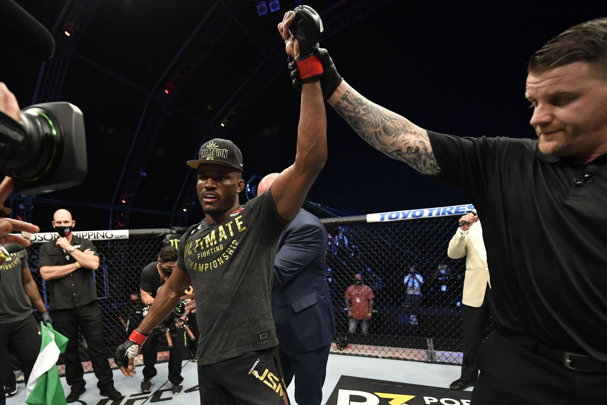 In this handout image provided by UFC, Kamaru Usman of Nigeria celebrates after his victory over Jorge Masvidal in their UFC welterweight championship fight during the UFC 251 event at Flash Forum on UFC Fight Island on July 12, 2020 on Yas Island, Abu Dhabi, United Arab Emirates.