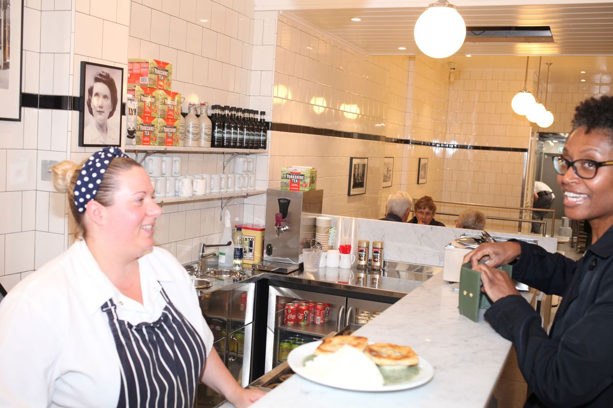 Service at G. Kelly - pie and mash shop on Roman Road in east London
