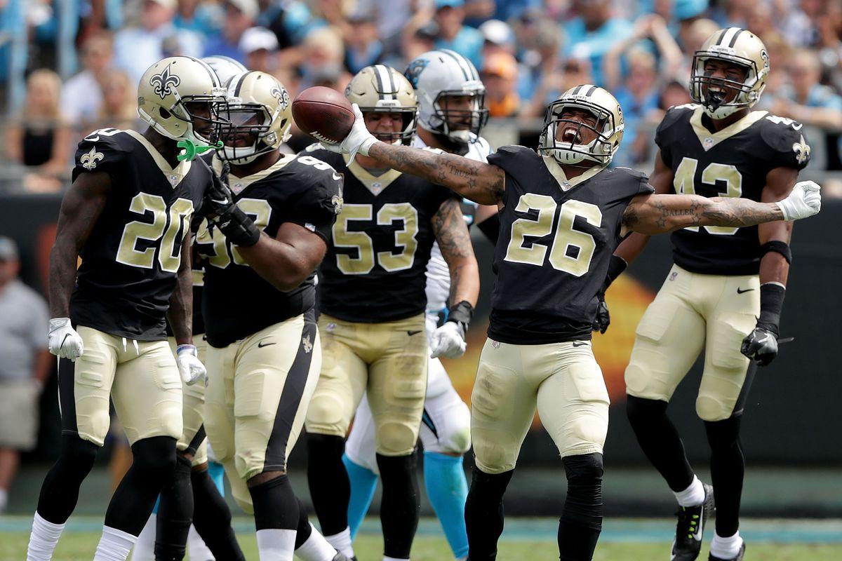 CHARLOTTE, NC:  New Orleans Saints players celebrate cornerback P.J. Williams' (26) interception of Carolina Panthers quarterback Cam Newton during a game at Bank of America Stadium.