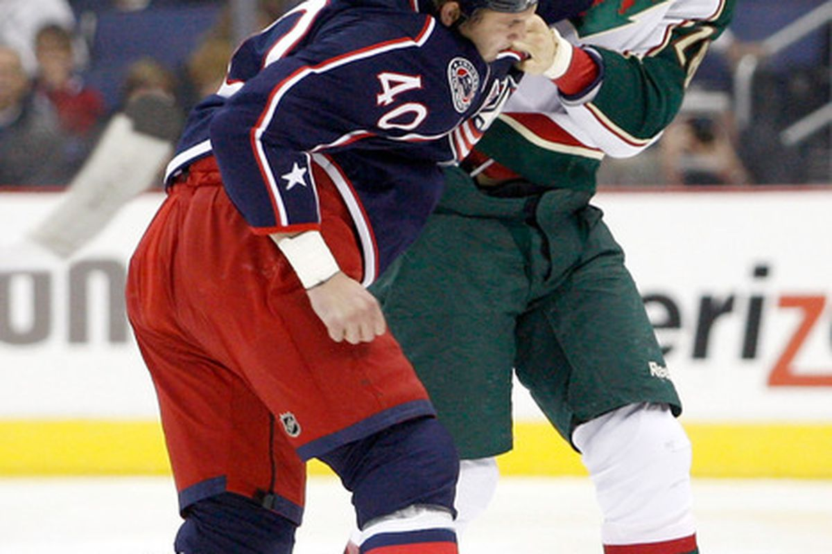 COLUMBUS OH - NOVEMBER 6:  Jared Boll #40 of the Columbus Blue Jackets fights with Matt Kassian #28 of the Minnesota Wild during the first period on November 6 2010 at Nationwide Arena in Columbus Ohio.  (Photo by John Grieshop/Getty Images)