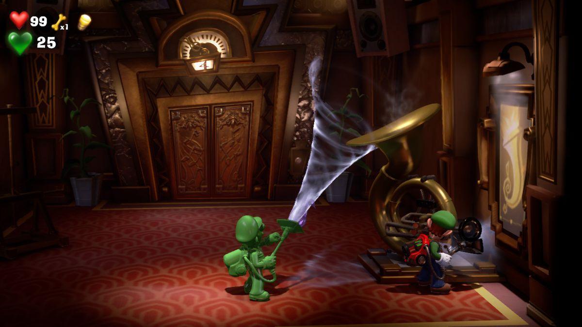 Luigi's Mansion 3 Luigi and Gooigi get the purple gem from a tube in the 4F Elevator Hall
