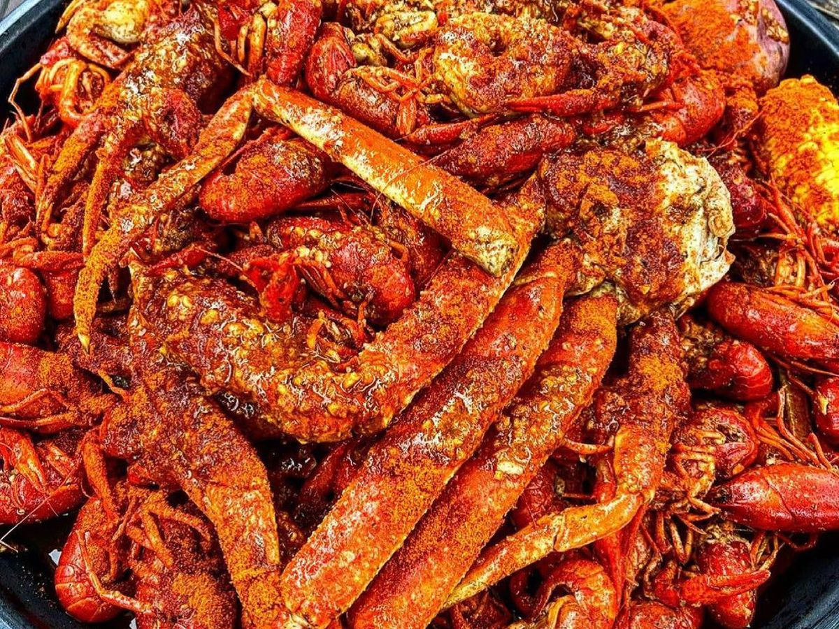 A big plate of boiled crawfish and snow crab legs