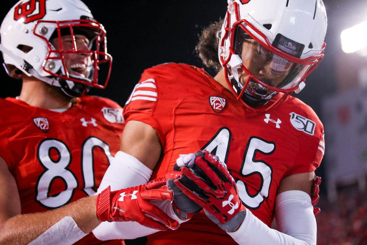 Utah Utes tight end Brant Kuithe (80) and wide receiver Samson Nacua (45) celebrate after Nacua scored a touchdown, putting the Utes up 14-7 over the Washington State Cougars after the PAT, at Rice-Eccles Stadium in Salt Lake City on Saturday, Sept. 28, 2019.