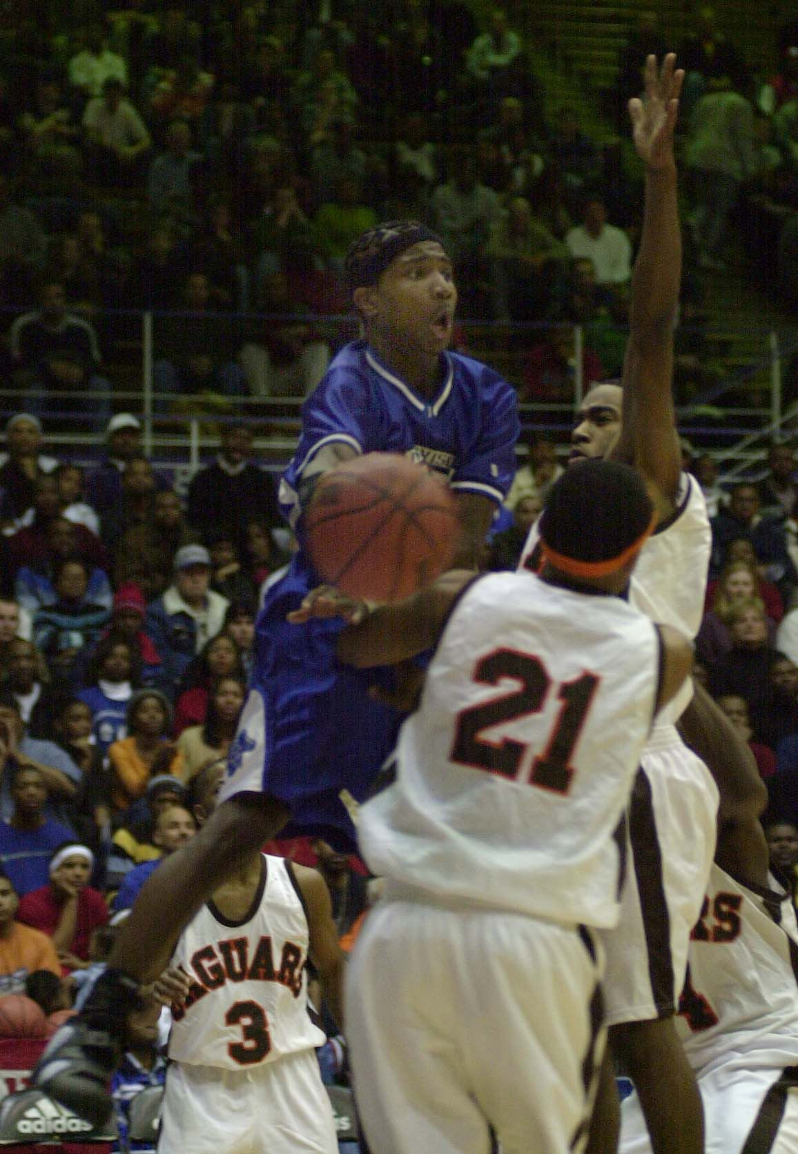 Proviso East's Dee Brown goes up for a pass around Julian's Karl Brown.