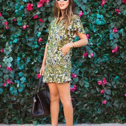 """Aimee of <a href=""""http://www.songofstyle.com""""target=""""_blank"""">Song of Style</a> is wearing a <a href=""""http://www.minusey.com/index.php/pineapple-linen-dress.html""""target=""""_blank"""">Minusey</a> dress, Seneca Eyewear sunglasses, and a Celine bag and heels."""