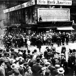 """FILE - In this April 1912 file photo, crowds gather around the bulletin board of the New York American newspaper in New York, where the names of people rescued from the sinking Titanic are displayed. It was a news story that would change the news. From the moment that a brief Associated Press dispatch relayed the wireless distress call _ """"Titanic ... reported having struck an iceberg. The steamer said that immediate assistance was required"""" _ reporters and editors scrambled. In ways that seem familiar today, they adapted a dawning newsgathering technology and organized saturation coverage and managed to cover what one authority calls """"the first really, truly international news event where anyone anywhere in the world could pick up a newspaper and read about it."""" (AP Photo)"""