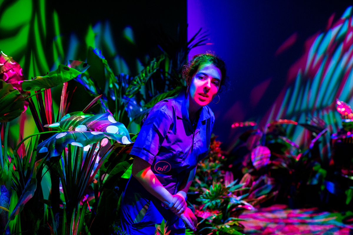 Dream machine garden room with female employee under multi-colored lights