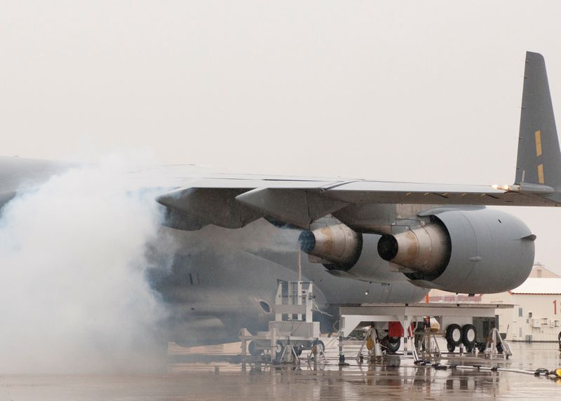 NASA and US Air Force employees blow ash up a C-17 aircraft's engines to simulate flying through a volcanic ash cloud. The ash was sourced from an ancient volcano in Oregon.