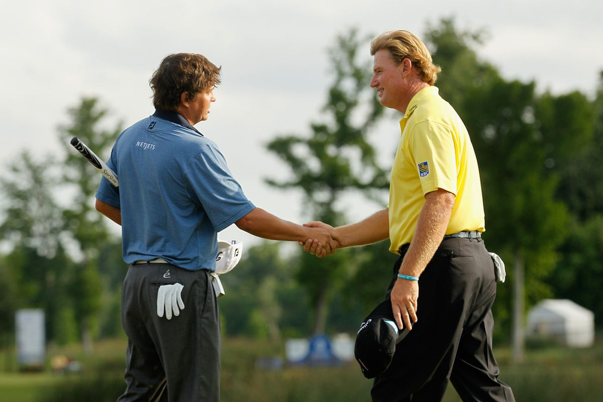 Ernie Els (right) congratulates Auburn graduate Jason Dufner on his first tour win at yesterday's Zurich Classic.
