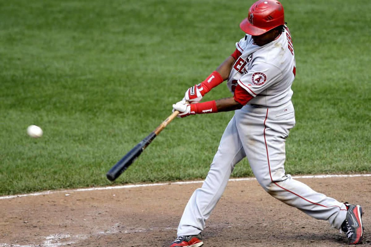 Los Angeles Angels' Erick Aybar hits a two-run RBI single during the 13th inning of a baseball game against the Baltimore Orioles, Sunday, Aug. 16, 2009, in Baltimore. The Angels won 17-8. (AP Photo/Rob Carr)