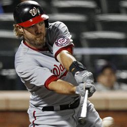 Washington Nationals right fielder Jayson Werth hits a sixth-inning RBI single during the Nationals' baseball game against the New York Mets in New York, Tuesday, April 10, 2012.