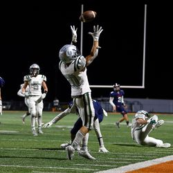 Olympus' Josh Peterson reaches up for an interception as the Titans and Brighton play a high school football game at Brighton in Cottonwood Heights on Friday, Sept. 10, 2021. Olympus won 35-28.