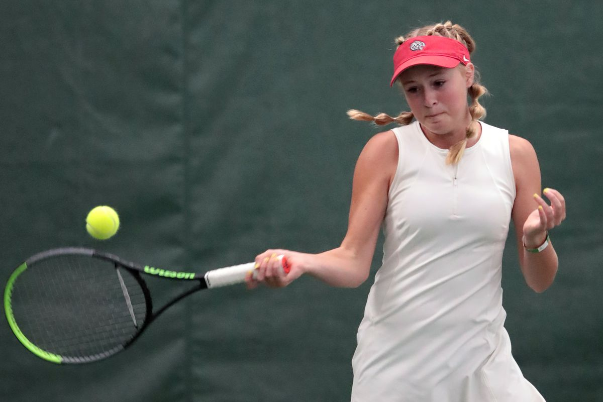 Woods Cross High School's Sage Bergeson hits a return as she and Highland's Dylan Lolofie battle for the 5A tennis state championship.