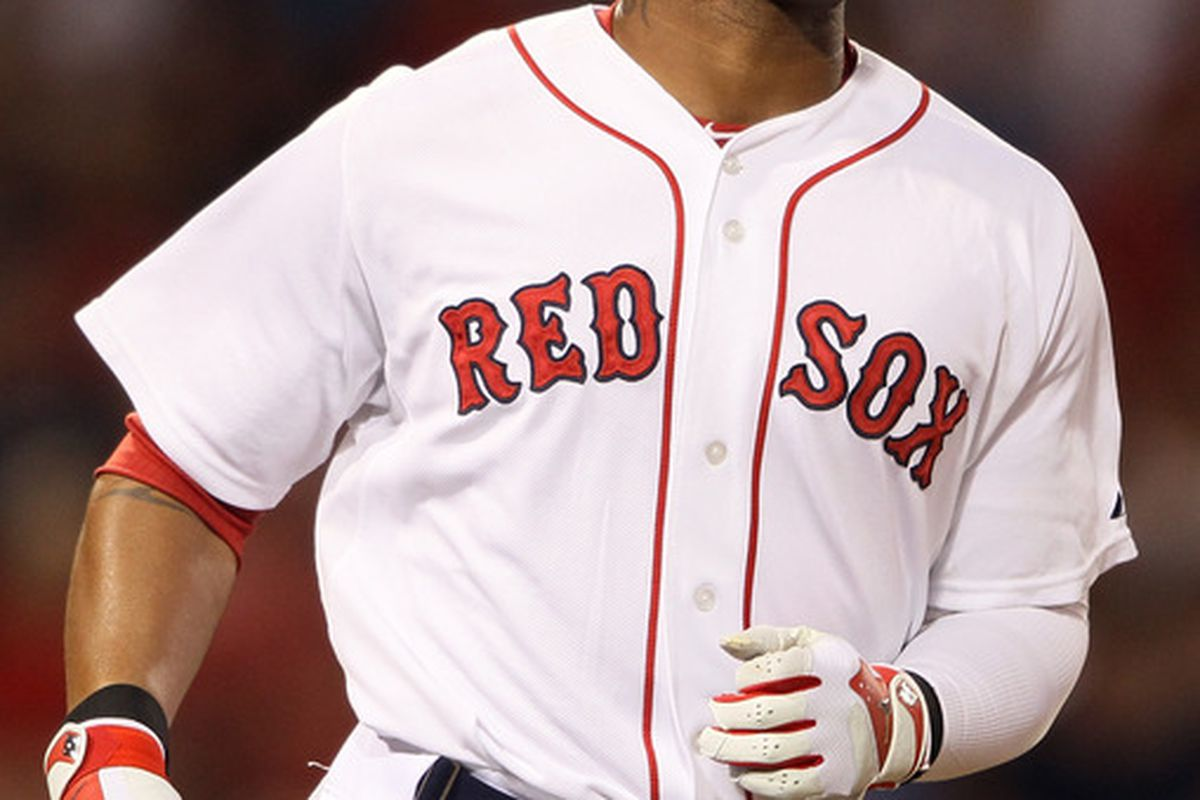 Carl Crawford of the Boston Red Sox could be out another three months with a UCL sprain.  (Photo by Elsa/Getty Images)