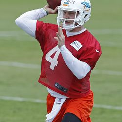 DAVIE, FL - MAY 23: Brock Jensen #4 of the Miami Dolphins throws the ball during the rookie minicamp on May 23, 2014 at the Miami Dolphins training facility in Davie, Florida.