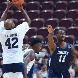 Khalid El-Amin attempts a jump shot over the arm of Hilton Armstrong.