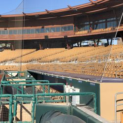 The protective netting extends to the end of both dugouts at Camelback Ranch.