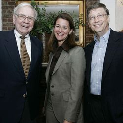 Warren Buffett, left, Melinda French Gates and Bill Gates stand together, Sunday, June 25, 2006, in New York, shortly after Buffett's announcement that he would be starting to make an annual donation of about $1.5 billion to the Bill & Melinda Gates Foundation.