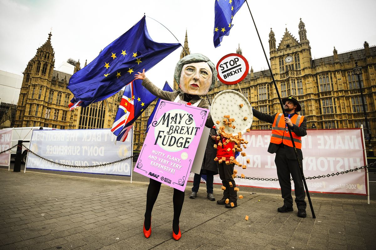 December 10: A demonstrator dressed as Theresa May sells Brexit Fudge in Old Palace Yard, in Westminster, London. Read More. (Kirsty O'Connor/PA Images via Getty Images)