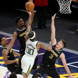 Memphis Grizzlies forward Jaren Jackson Jr. (13) blocks Utah Jazz guard Jordan Clarkson (00) as the Utah Jazz and the Memphis Grizzlies play in game one of their NBA playoff series at Vivint Arena in Salt Lake City on Sunday, May 23, 2021. Memphis won 112-109.