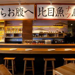The ten seat ground-level sushi bar, made from cypress wood
