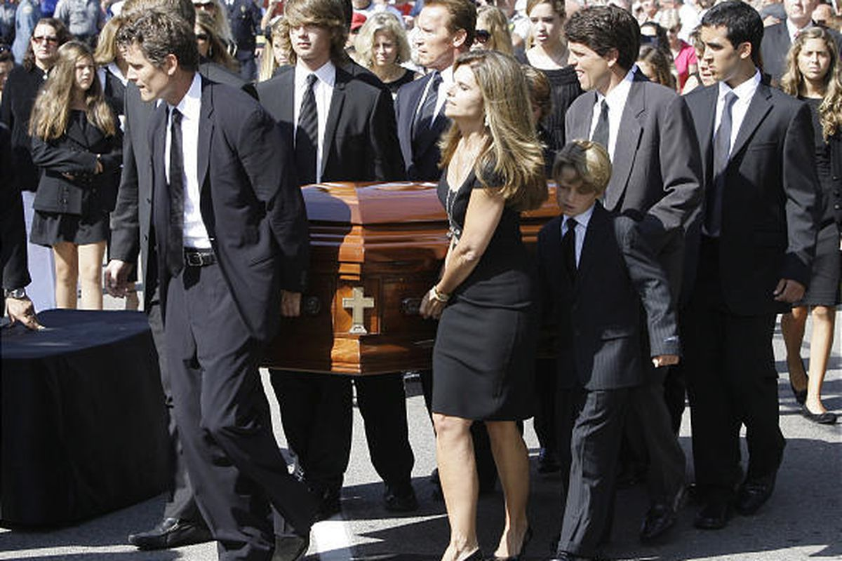 Members of the Shriver family, including Anthony Shriver, left, his sister Maria, front center, her husband, Gov. Arnold Schwarzenegger, rear center, and Tim Shriver, right, carry the casket of Eunice Kennedy Shriver on Friday.