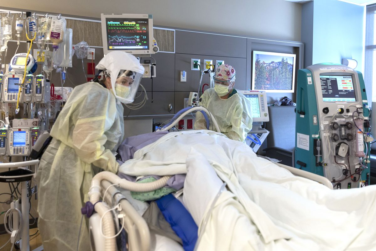 Medical staff treat a patient in a COVID-19 intensive care unit atIntermountain Healthcare's Utah Valley Hospitalin Provo.