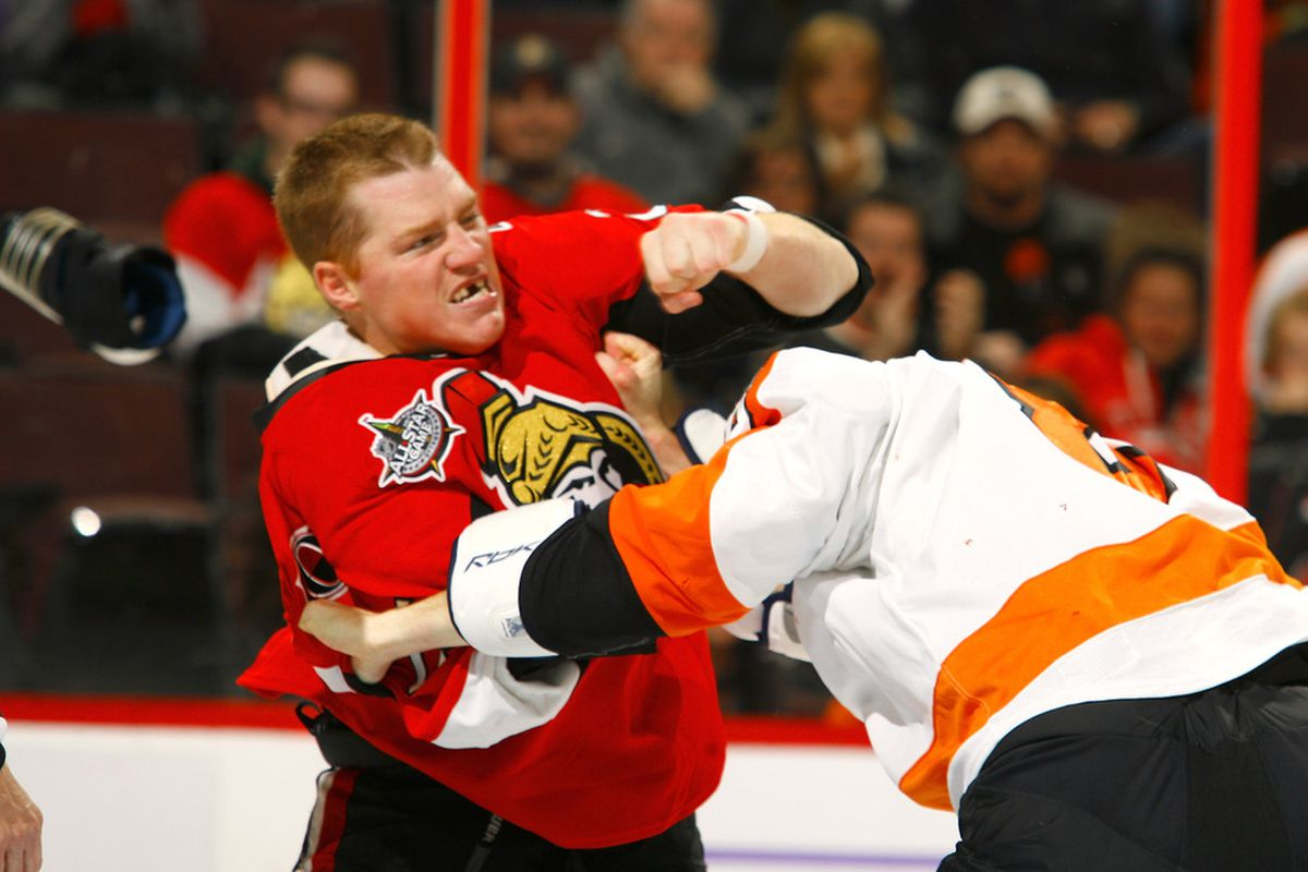 Chris Neil punches the head of Matt Walker clean off during a game at Scotiabank Place on October 18, 2011 in Ottawa, Ontario, Canada.  (Photo by Phillip MacCallum/Getty Images)