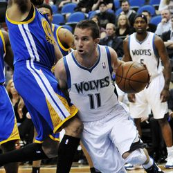 Minnesota Timberwolves' J.J. Barea, right, drives around Golden State Warriors' Mikki Moore during the first half of an NBA basketball game Sunday, April 22, 2012, in Minneapolis.