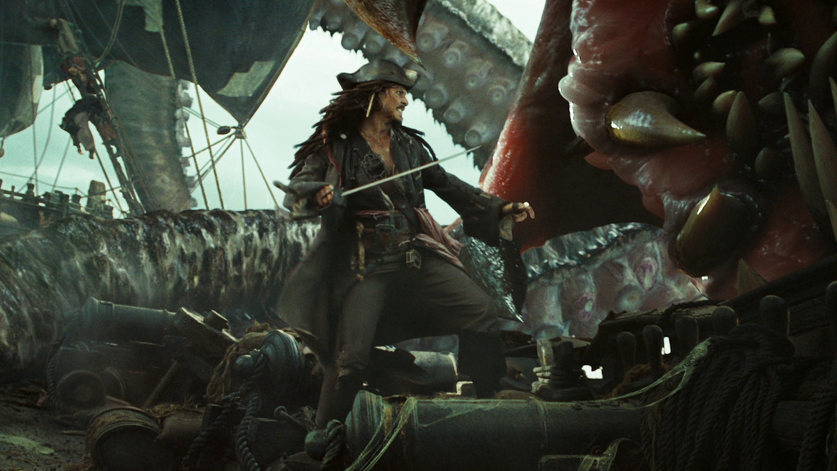 jack sparrow prepares to stab the kraken's mouth in dead man's chest