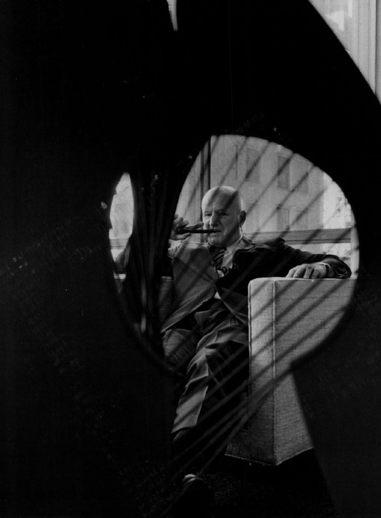 Architect William E. Hartmann, seen through a fluted area of a scale model of the Picasso. | Sun-Times files